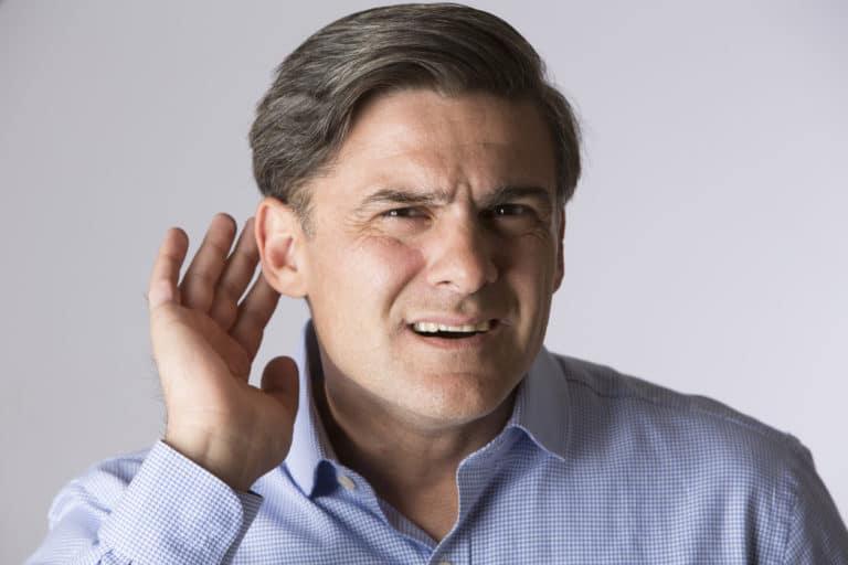 Studio Shot Of Man Suffering From Deafness