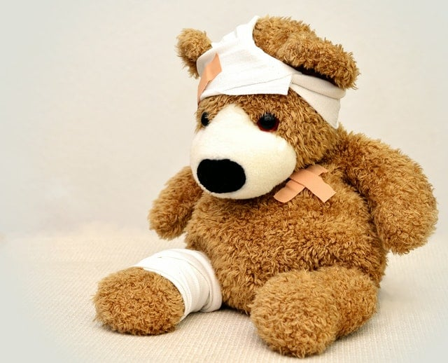 Teddy bear covered in bandages