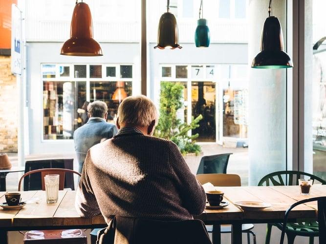 Man sits inside of coffee shop